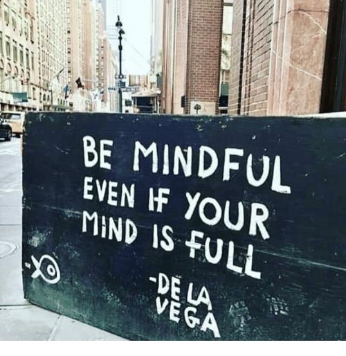 image of a wall that says BE MINDFUL EVEN IF YOUR MIND IS FULL - De La Vega