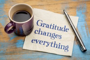 """coffee cup, note that say """"Gratitude Changes Everything"""""""